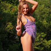 cute_blonde_strips_in_the_field-7
