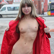 hot_blonde_flashing_by_removing_an_overcoat-3